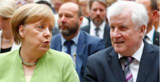不得不妥协!默克尔同意阻止难民进入德国并遣送出境