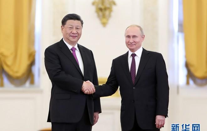 习近平同俄罗斯总统?#31449;?#20030;行会谈